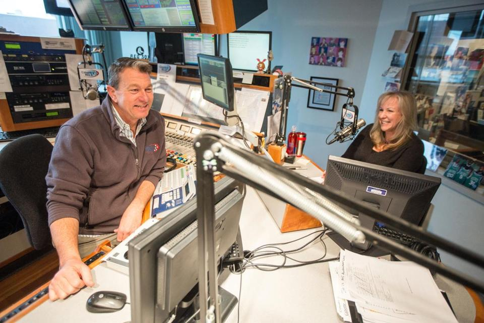 03/04/2015 BOSTON, MA Morning DJ's John Willis (cq) (left) and Lori Grande (cq) broadcast from WKLB in Boston. (Aram Boghosian for The Boston Globe)