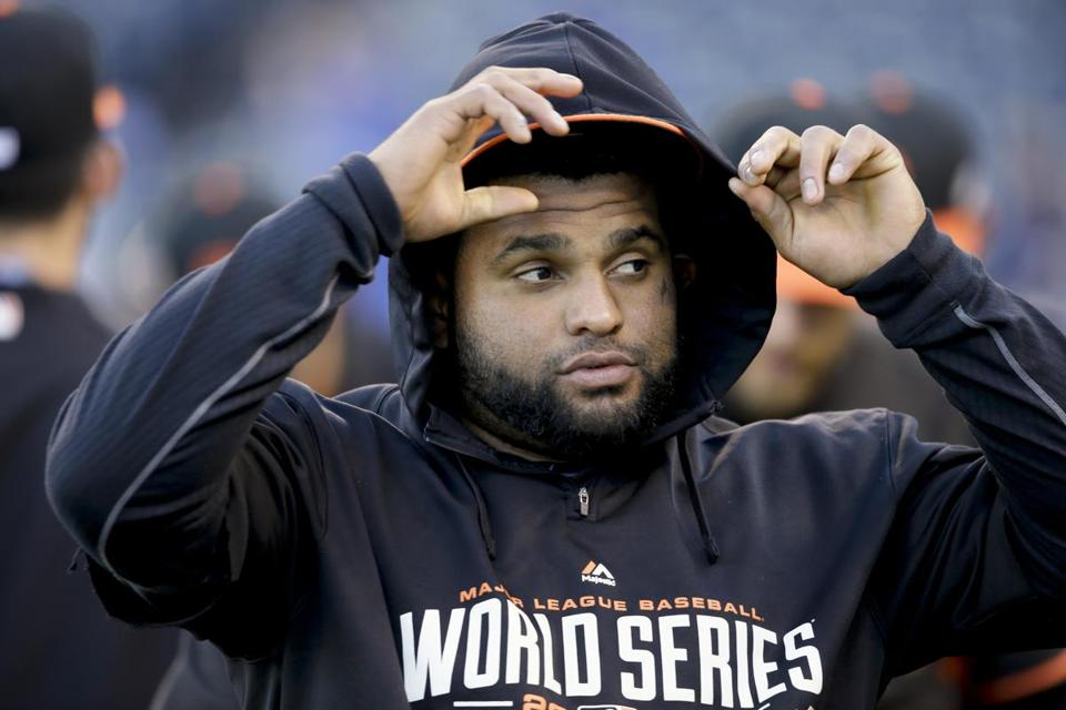 San Francisco Giants third baseman Pablo Sandoval arrives for Game 7 of baseball's World Series against the Kansas City Royals Wednesday, Oct. 29, 2014, in Kansas City, Mo. (AP Photo/Charlie Neibergall)