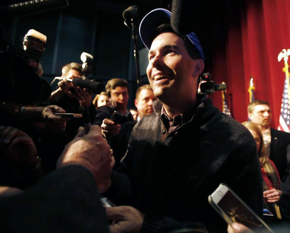 In N.H., Scott Walker pointed out that he was wearing a sweater he bought for a dollar at Kohl's.