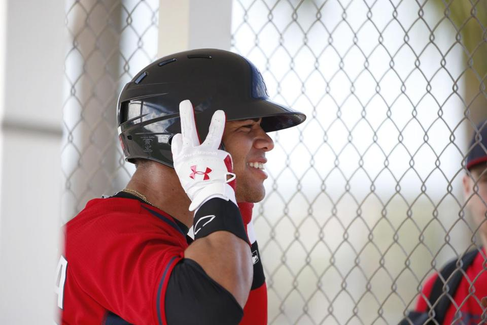 Boston Red Sox' Yoan Moncada waits to bat during practices at spring training, Friday, March 13, 2015, in Fort Myers Fla. The Red Sox have finalized a minor league contract with the 19-year-old Cuban infielder that includes a $31.5 million signing bonus, easily a record for an international amateur free agent under 23 years old. (AP Photo/Brynn Anderson) )