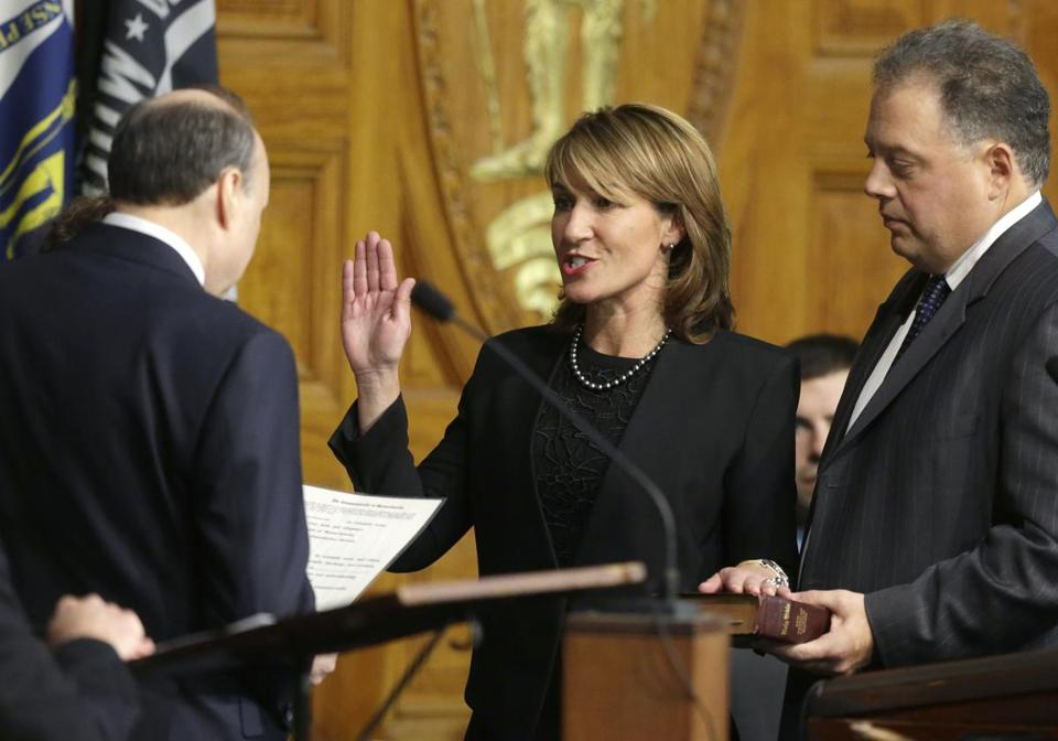 Karyn Polito with her husband, Stephan Rodolakis (right), when she was sworn in as lieutenant governor in 2015.