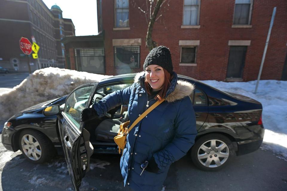 BOSTON, MA - 3/18/2015: ALL SMILES AND HAPPY TO HAVE HER CAR FREE TO DRIVE......Record Breaking.... largest record snowfall in the City of Boston's history; Jillian Tenen's car parked on Isabella Street went through weeks of storms and melting frozen in place at the same on street parking spot. (David L Ryan/Globe Staff Photo) SECTION: METRO TOPIC 19buriedcar(1)