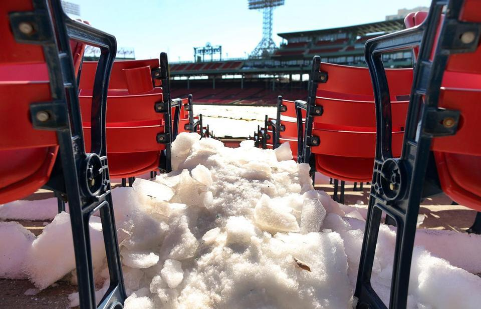 Snow was spotted between the rows of seats behind home plate at Fenway Park.