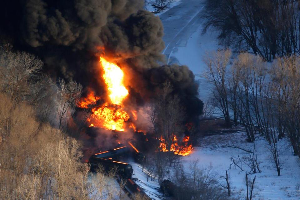 Smoke and flames erupted from railroad tank cars loaded with crude oil that derailed March 5 near Galena, Ill.