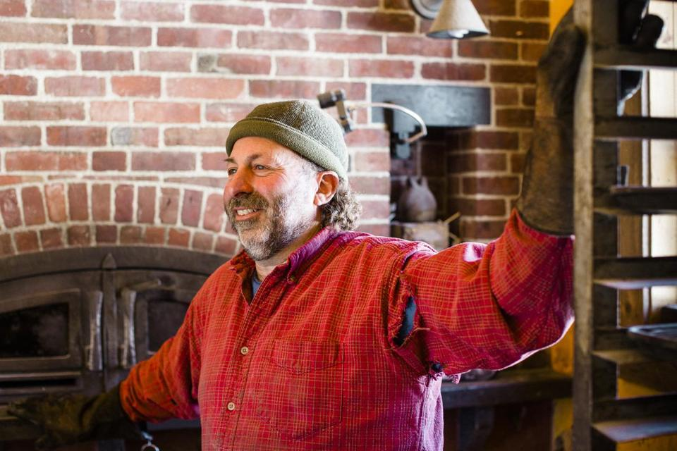 Vermatzah co-owner Doug Freilich standing in front of the wood fired oven at the Naga Bakehouse in Middletown Springs, VT. (Corey Hendrickson for The Boston Globe)