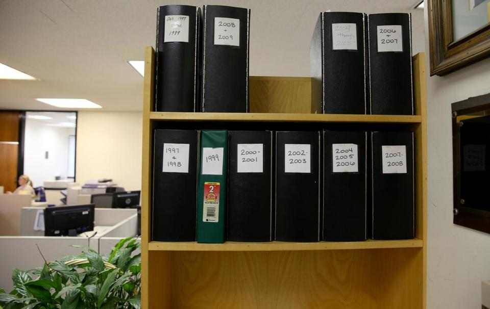 Despite a new computer system, citizens visiting  Quincy District Court have to look up criminal cases in paper indexes.