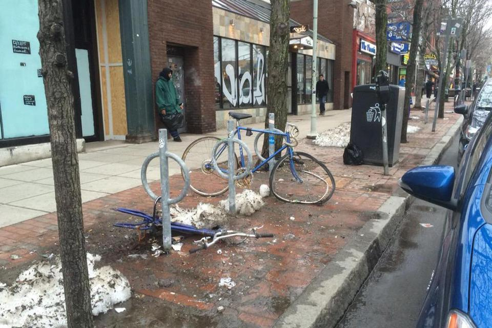 Damaged bikes and bike racks could be seen in Cambridge.