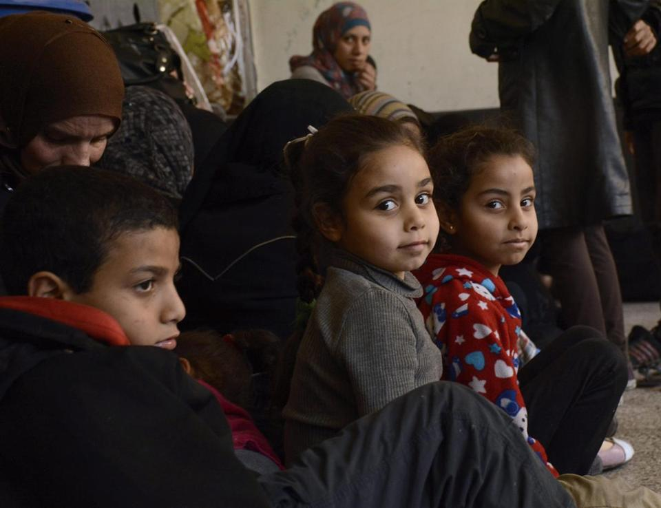 Palestinian refugees arrived at a makeshift center in Damascus, Syria, on Sunday amid widespread fighting.