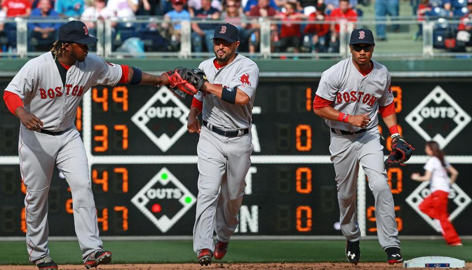 04/06/15: Philadelphia, PA: Red Sox outfielders Hanley Ramirez, Shane Victorino and Mookie Betts celebrate their victory following the final out of the game. The Boston Red Sox visited the Philadelphia Phillies for their 2015 MLB season Opening Day game at Citizens Bank Park. (Globe Staff Photo/Jim Davis) section: sports topic: Red Sox-Phillies