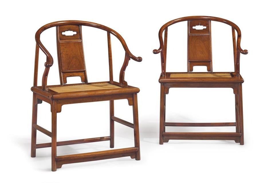 These are two from the set of four 17th-century Chinese huanghuali armchairs that sold for $9.68 million against an $800,000-$1.2 million estimate at Christie's Asian Week auctions. It is the highest price ever paid at auction for furniture made of huanghuali, a rare Chinese wood reserved mostly for furniture made for the court and the wealthy.