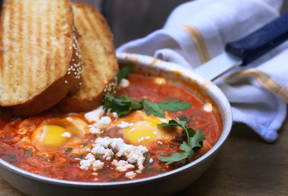 Boston, MA 041015 Shakshuka or poached eggs topped with fresh tomato sauce and feta cheese from Tatte Bakery & Cafe in Boston, Friday, April 10 2015, (Globe Staff/Wendy Maeda) section: Lifestyle slug: 22tatte reporter: Jill Radsken