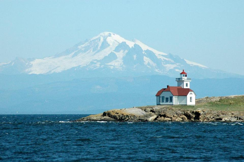 The Patos Island Lighthouse in front of Mt. Baker in Washington's San Juan Islands.; Shutterstock ID 97761230; PO: 4/19 TRAVEL