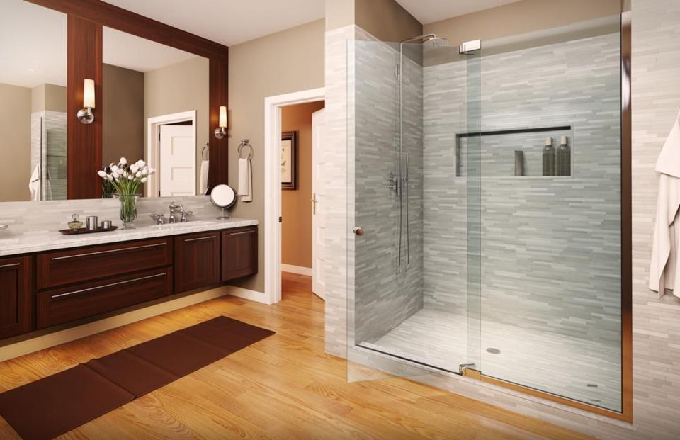 Frameless heavy-glass enclosures are a huge design trend because they give a bathroom that spacious, luxury spa-like feeling homeowners want.