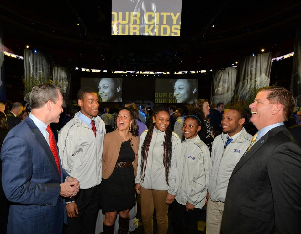 John Fish (left), Rebekah Splaine Salwasser of Boston Scholar Athletes (third from left), and Mayor Marty Walsh with students (from left) Brian Donna, Simone McLaren, Vanessa Nedd, and Brandon Newton.
