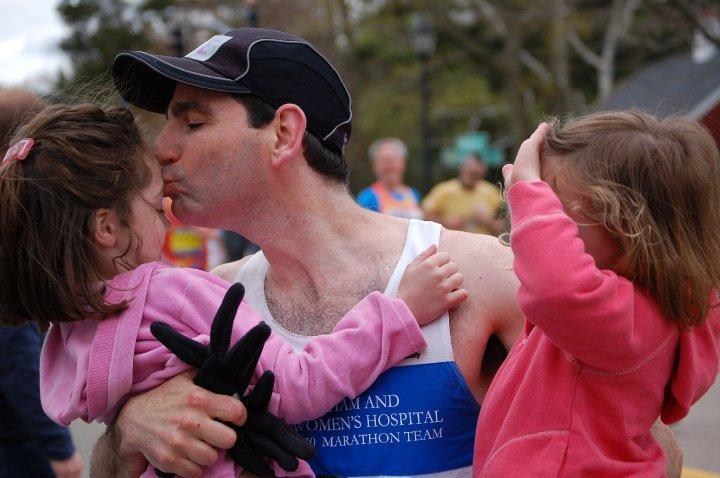 Dr. Michael Davidson's daughters Kate (left) and Liv met him as he ran the 2010 Marathon.