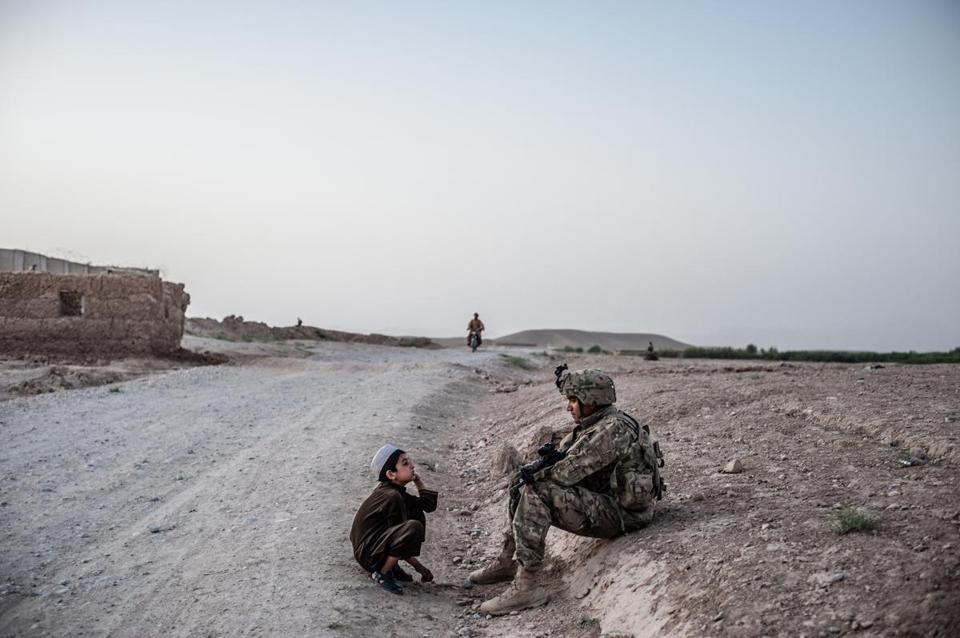 "In ""Zabul, 2011,"" an Afghan boy and a US soldier in Qalat, the capital of Zabul Province."