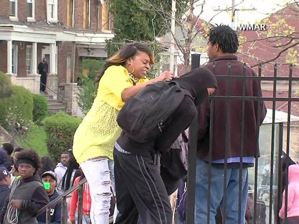In a video that has gone viral, Toya Graham is seen slapping her 16-year-old son for participating in Monday's riots in Baltimore.