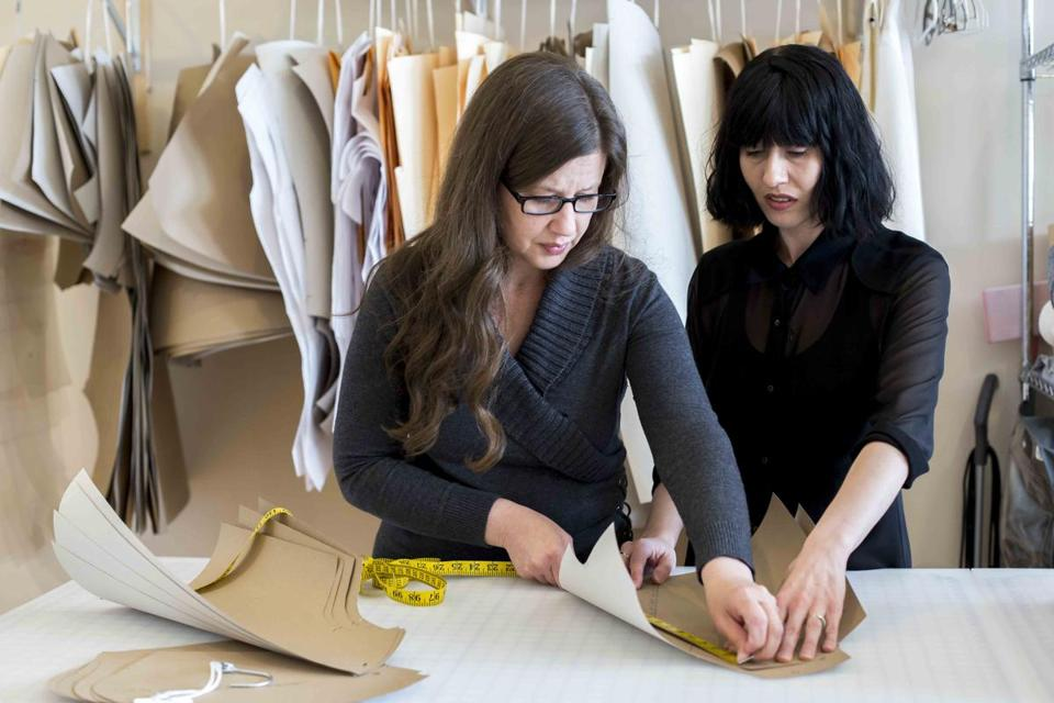 At Good Clothing Co. in Mashpee, founder Kathryn Hilderbrand (left) reviewed patterns with Aiste Zitnikaite.