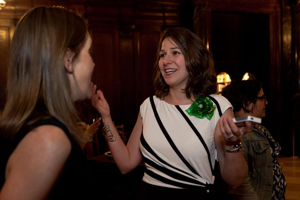 Author Elaine Dimopoulos greets Erin Galloway at the BPL party.