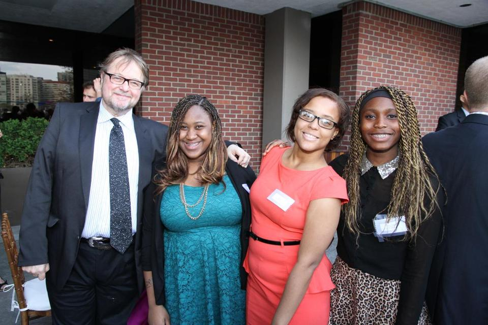 From left: writer Luis Alberto Urrea with 826 Boston students Stevelyn Desire, Julia Teixeira, and Agnes Ugoji at the benefit.