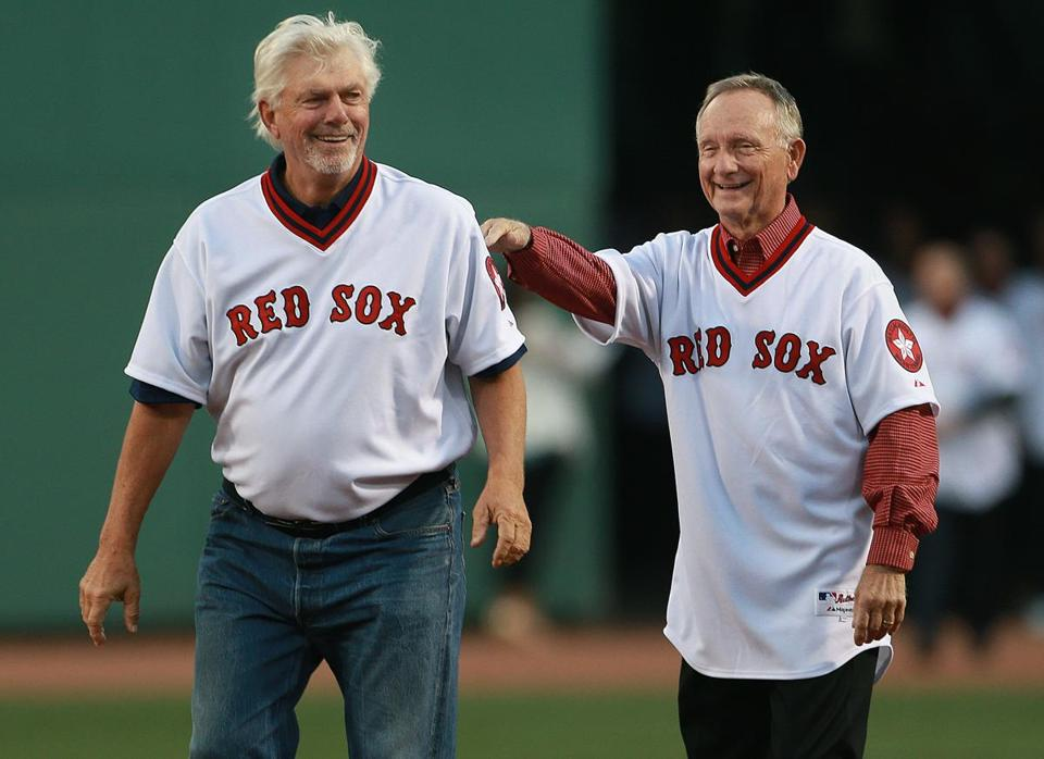 05/05/15: Boston, MA: The Red Sox honored their 1975 American League Champion team before the game, and the current team wore throwback uniforms from that season during the game. Here 2B Denny Doyle (right) shows pitcher Bill Lee where the mound is as he heads for the hill after being introduced. The Boston Red Sox hosted the Tampa Bay Rays in a regular season MLB game at Fenway Park. (Globe Staff Photo/Jim Davis) section: sports topic: Red Sox-Rays(1)
