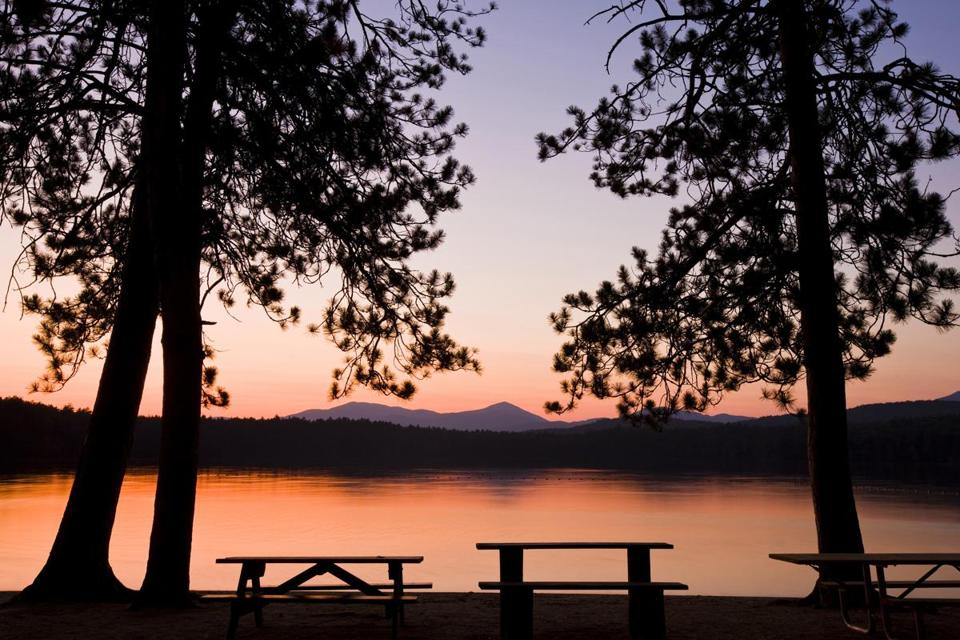 Picnic benches after sunset at White Lake State Park in Tamworth, New Hampshire, USA. (Danita Delimont/Gallo Images/Getty Images)