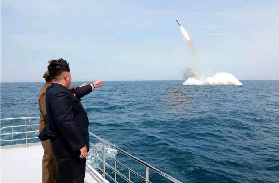 An image obtained by the Yonhap News Agency is said to show North Korean leader Kim Jong Un observing a ballistic missile's launch from under water Saturday off Sinpo.