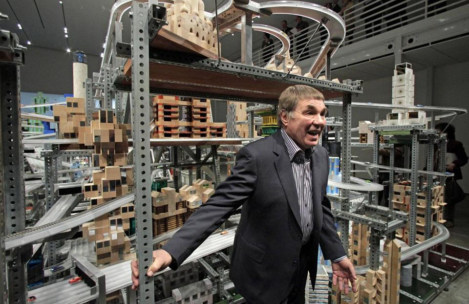 "Mr. Burden posed for photos in front of his sculpture ""Metropolis II"" at the Los Angeles County Museum of Art in Los Angeles."