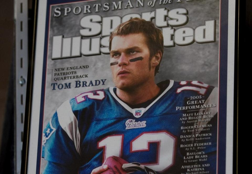 A Sports Illustrated cover showing Tom Brady is in the trophy case at Junipero Serra High School in San Mateo, Calif. — also the alma mater of Barry Bonds.