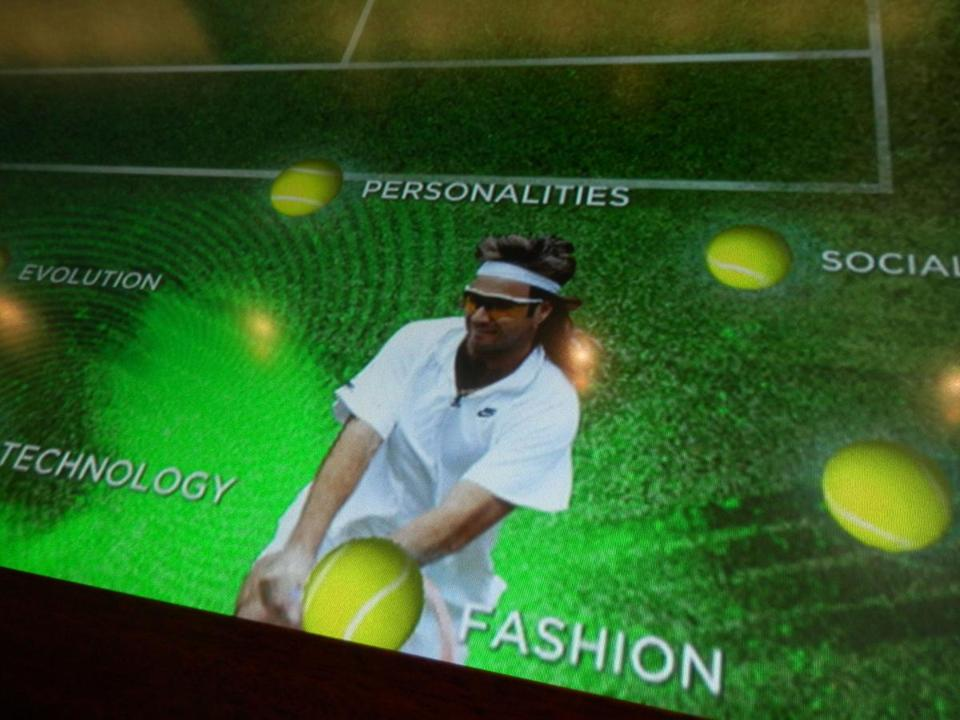 The redesigned International Tennis Hall of Fame in Newport, R.I., has added a five-foot interactive touch screen table where visitors can challenge an opponent to a game of trivia or learn about players, fashion, technology, and other facts through the years.