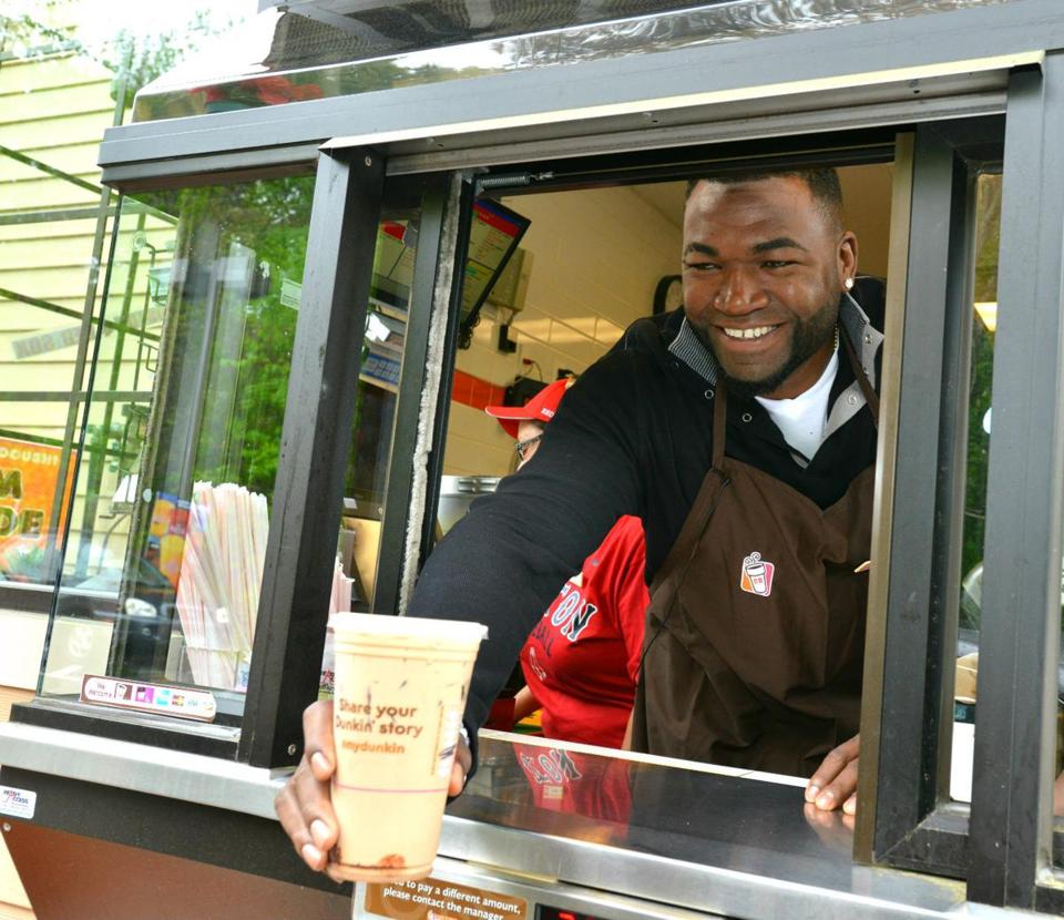 Red Sox slugger David Ortiz served customers at the drive-thru window at a Dunkin' Donuts in New Hampshire as part of a promotion for the coffee chain.