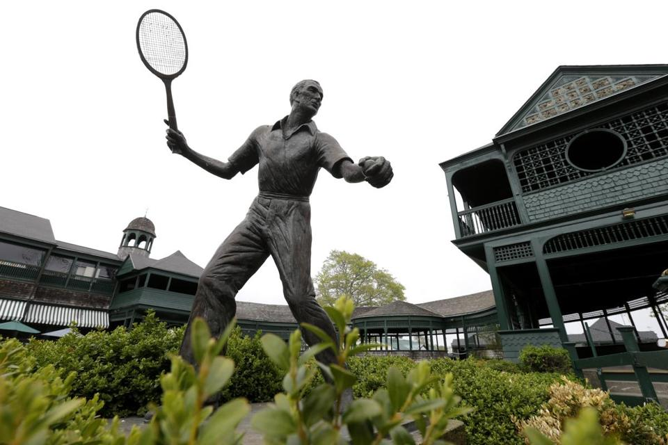 In this Monday, May 11, 2015 photo a bronze statue of British tennis champion Frederick J. Perry, by British sculptor David Wynne, stands at the International Tennis Hall of Fame, in Newport, R.I. Perry won numerous tennis championships in the first half of the twentieth century, including Wimbledon three times. The International Tennis Hall of Fame is to reopen its museum May 20 after a complete renovation. (AP Photo/Steven Senne)