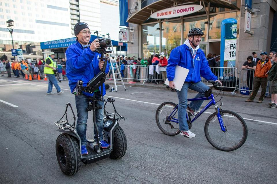Jason Bui rides a Segway while making a video for the Virtual Runner app that allows runners to race on courses (such as Falmouth, below) using a treadmill and video screen.