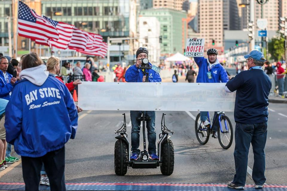 Jason Bui (on Segway) of Outside Interactive records the route of the Run to Remember along Seaport Boulevard in Boston.