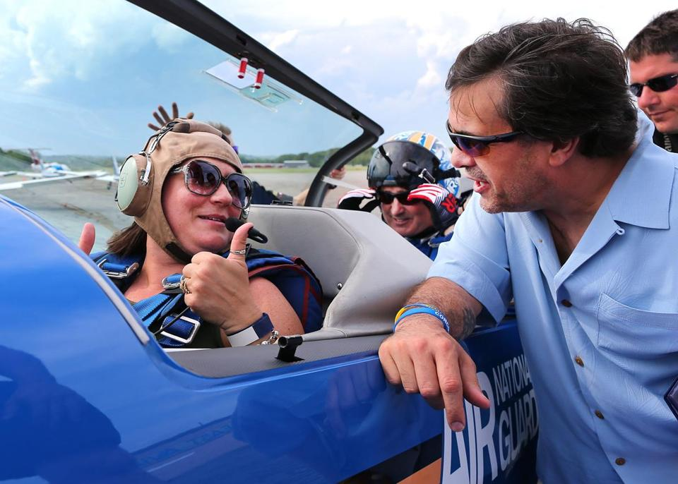 Celeste gave her husband, Kevin, the thumbs up from the front seat before takeoff.