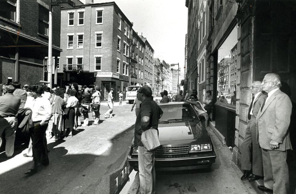 Donato Angiulo (right) and his brother Francesco watched a jury visiting their Prince Street offices in 1985.