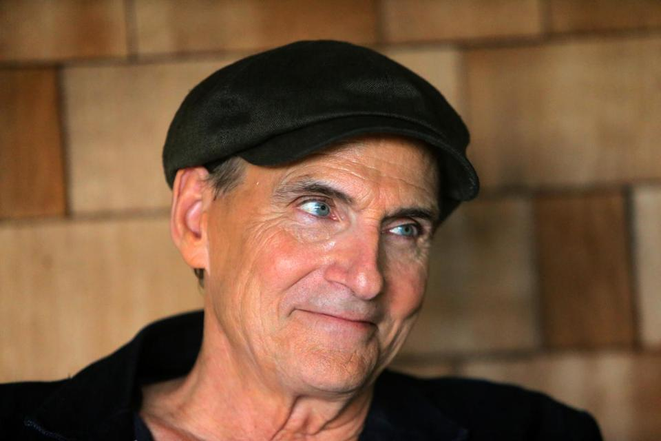 """I'm re-encouraged that I can still do this and it still works,"" said James Taylor, pictured sitting on the porch of his Lenox home."