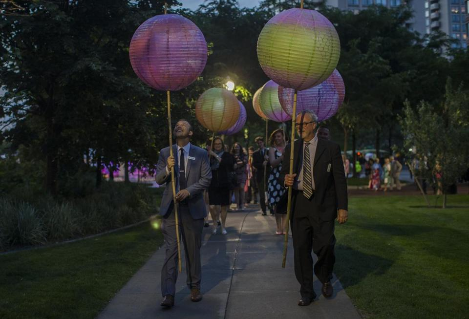 Michael Nichols and Steven Anderson carried paper lanterns during the gala.