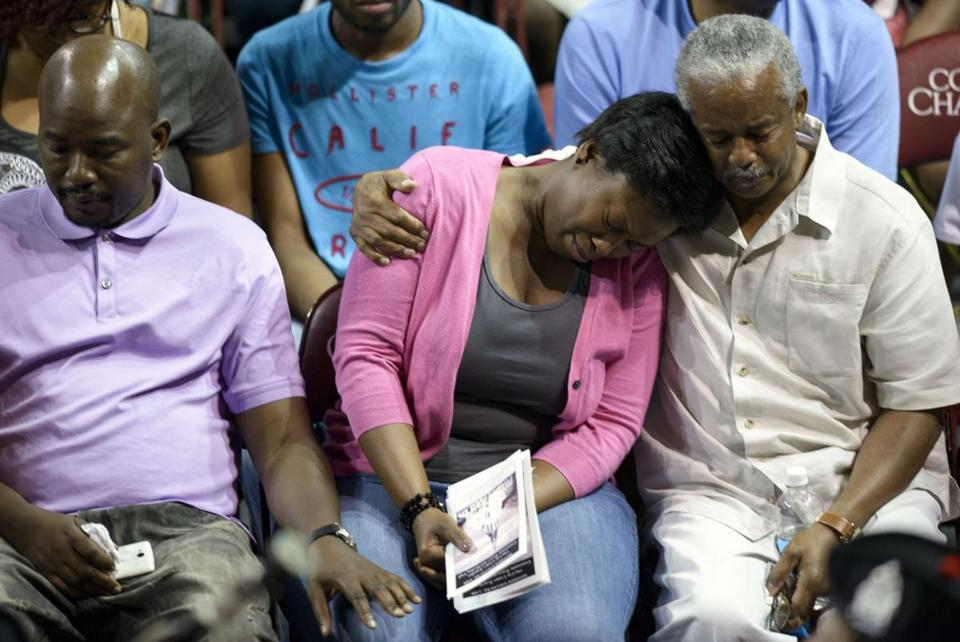 TOPSHOTS Loved ones of victims and others attend a vigil at TD Arena for victims of the recent church shooting in Charleston, South Carolina on June 19, 2015. For someone reportedly bent on igniting a race war, Dylann Storm Roof had little to say for himself in the first of what will be many court appearances. The 21-year-old suspect in Wednesday night's massacre at an African-American church Bible study class spoke only to answer a judge's questions at a 14-minute bail hearing. AFP PHOTO/BRENDAN SMIALOWSKIBRENDAN SMIALOWSKI/AFP/Getty Images