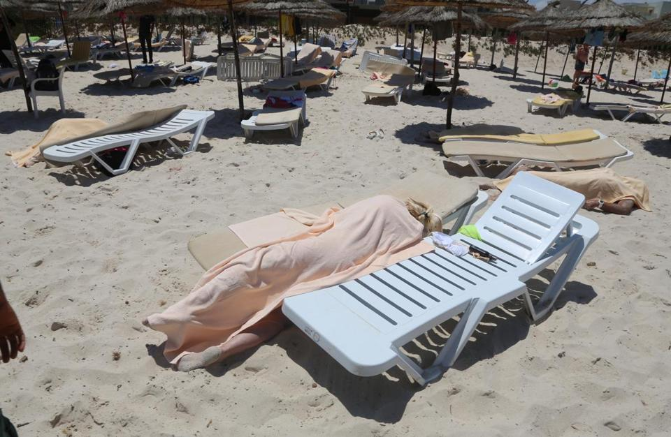 Bodies lay on a Tunisian beach after a shooting spree.