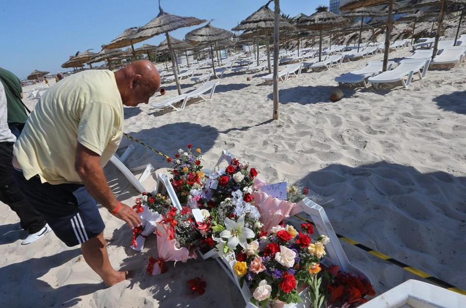 A man laid flowers Saturday at the site of Friday's attack at the Imperial Marhaba Hotel in Sousse, Tunisia.