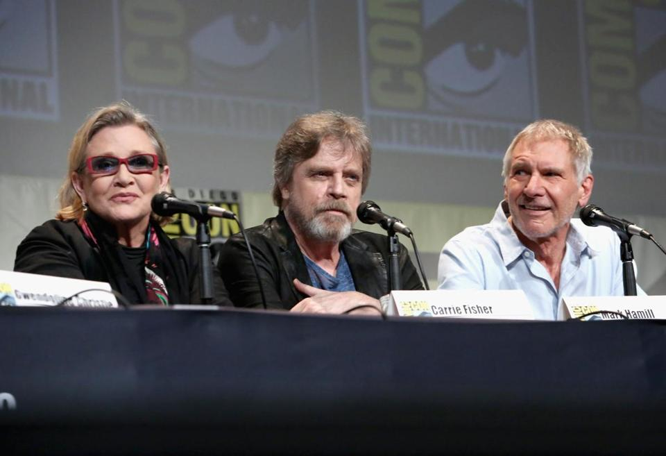 "Carrie Fisher, Mark Hamill, and Harrison Ford atpanel for ""Star Wars: The Force Awakens"" during Comic-Con on July 10, 2015 in San Diego."