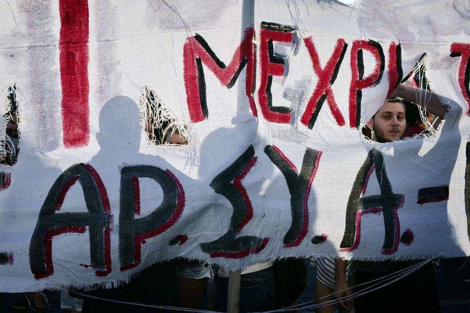 Protesters stood behind a banner during an anti-EU demonstration in Athens Sunday calling for a 'no' to any agreement with creditors that would lead to further austerity measures.