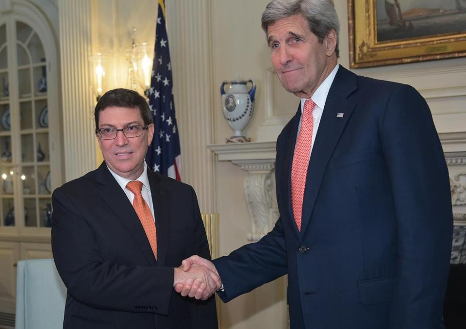 John Kerry (right) shook hands with Cuba's Foreign Minister.