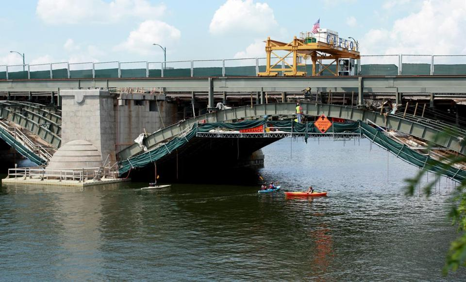 Kayakers passed under the Longfellow Bridge as it undergoes a restoration project.