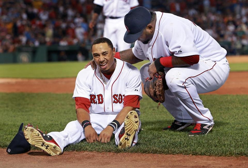 Third baseman Pablo Sandoval came to the aid of center fielder Mookie Betts, who was injured trying to make a catch in the sixth inning.