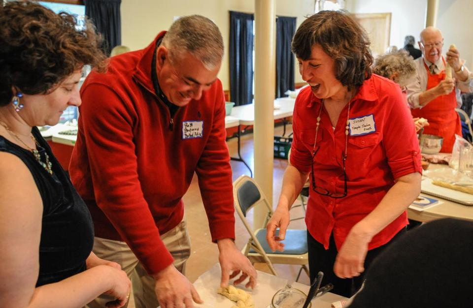 Bedford Police Chief Robert Bongiorno shaped his challah with the help of Rabbi Susan Abramson during a challah bread making lesson at the First Church of Christ in Bedford.