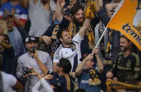 Fans react during an LA Galaxy-New England Revolution match.