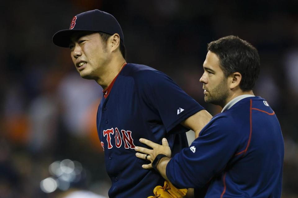 Koji Uehara was helped off the field by a trainer after being struck on the wrist Friday night.