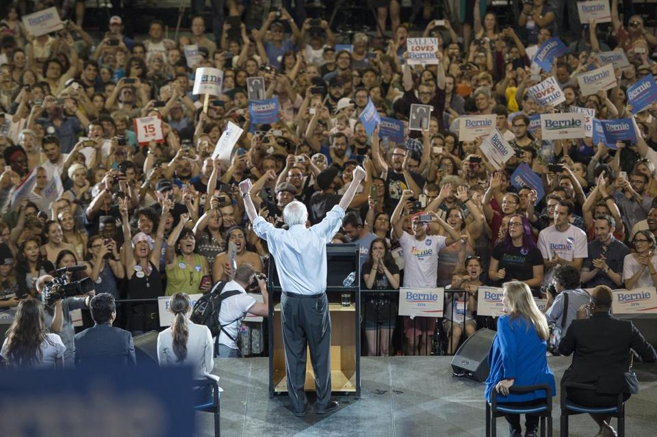 Democratic primary candidate Bernie Sanders, an independent senator from Vermont, lifted his arms in celebration before an estimated 28,000 people in Portland, Ore., Sunday.